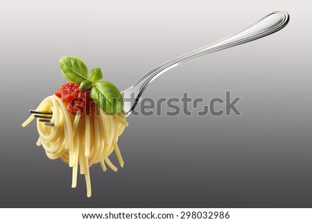 Forkful of spaghetti with tomato and basil