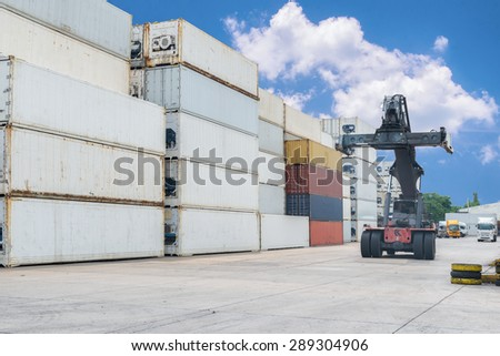 forklift and container box at  industrial port - stock photo