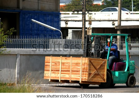Forklift at warehouse - stock photo