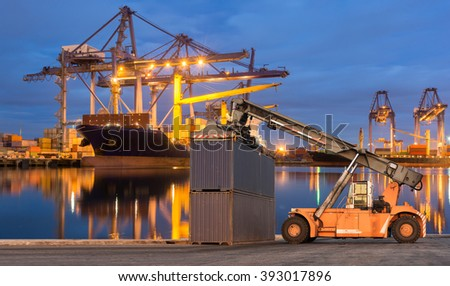 Forklift handling container box loading at port cargo - stock photo