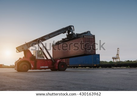 forklift handling holding container box at harbor logistic zone - stock photo
