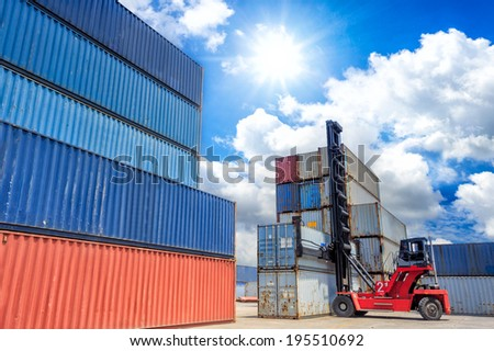 Forklift handling the container box at work in port  - stock photo