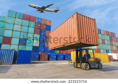 forklift handling the container box in logistic zone - stock photo