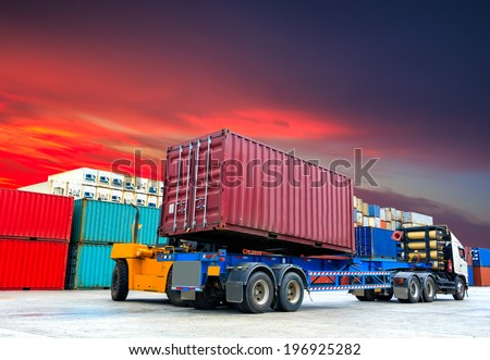 Forklift handling the container box up Truck at docks - stock photo