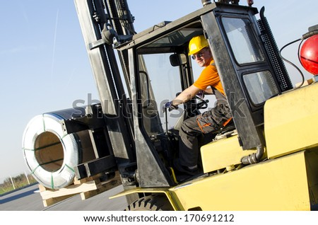 forklift in front of production hall - stock photo