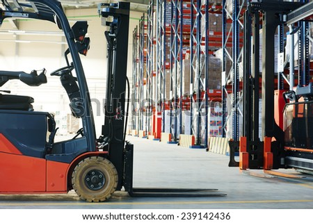 forklift loader pallet stacker truck equipment at warehouse - stock photo