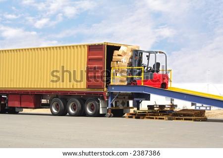Forklift on loading dock - stock photo