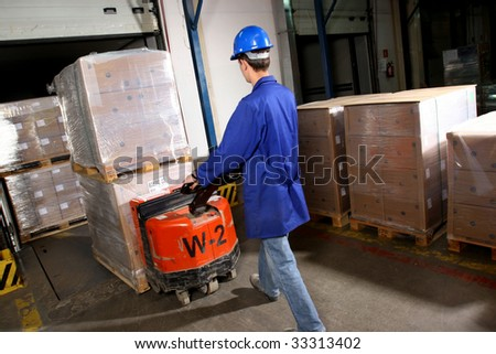 Forklift operating in Warehouse - stock photo