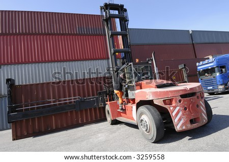forklift stacking containers in commercial container-port
