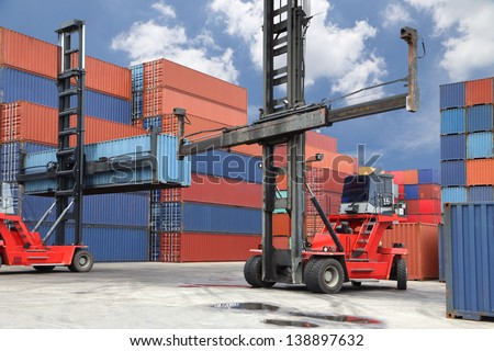 Forklift working in container yard - stock photo