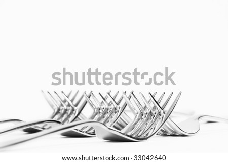 Forks fitted into each other - stock photo