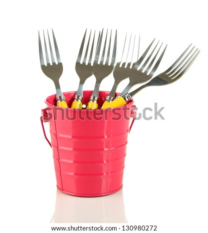 Forks in metal bucket, isolated on white - stock photo