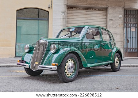 """FORLI, ITALY - OCTOBER 20: old Italian car Lancia Ardea (1951) at rally of classic cars, during the festival """"Borghi in festa"""" on October 20, 2013 in Forli, Italy  - stock photo"""