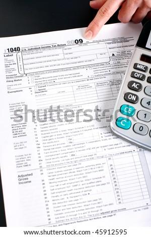 Form 1040. Standard US Income Tax Return. Calculator - stock photo