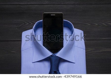 formal blue shirt and cellphone pun in collar - stock photo