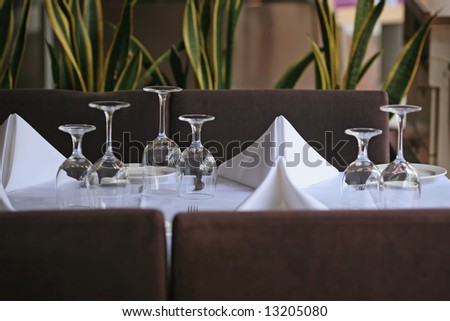 formal dining setting with nicely folded napkins - stock photo