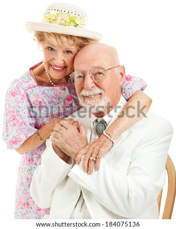 Formal portrait of a traditional Southern senior couple in love.  White background.   - stock photo