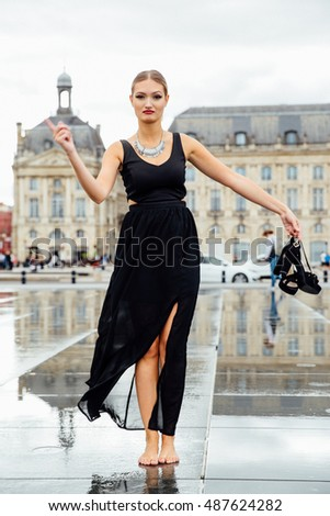 Formally Dressed Blonde Carries Shoes Stock Photo Edit Now