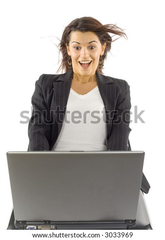 Formalwear woman's sitting with laptop on her knees. There's strong wind blowing from computer's screen. Isolated on white in studio. - stock photo