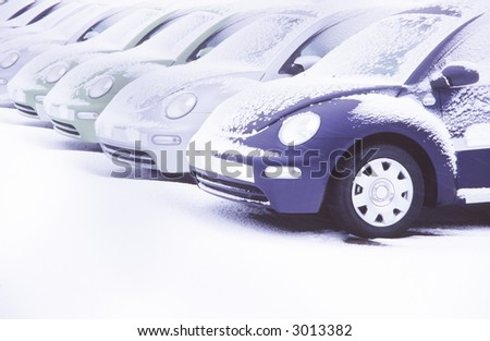 Formation of new cars covered with snow.
