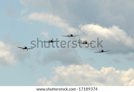 Formation of old propeller planes approaching