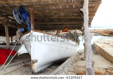 Formentera traditional boat stranded on wooden rails