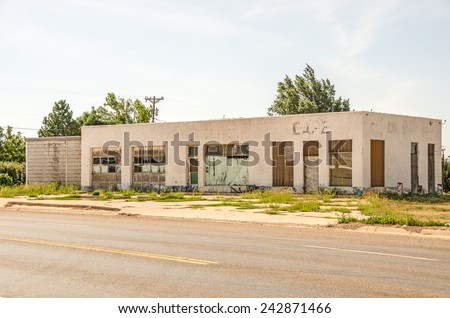 Former auto repair shop turned cafe and now abandoned on Route 66. - stock photo