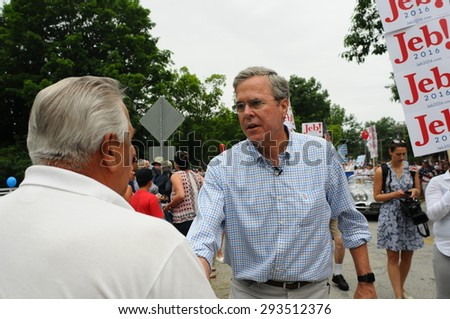 Former Florida Governor Jeb Bush greets a voter at the Amherst, NH, Fourth of July parade on July 4, 2015 - stock photo