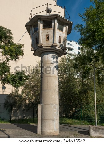 former watchtower of the GDR border in Berlin - stock photo