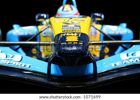 Formula One Renault. Shallow DOF. Focus on front of vehicle. - stock photo