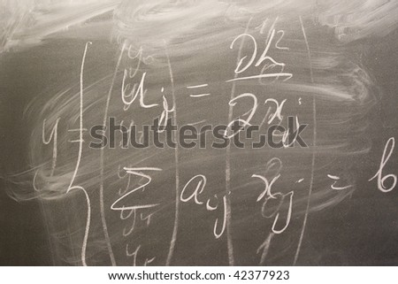 Formulas written on the board, education background. - stock photo