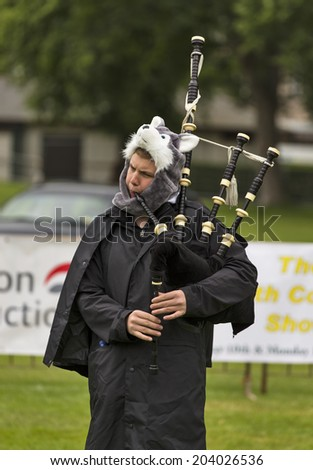 FORRES, MORAY, SCOTLAND - 28 JUNE: This is participants within the European Pipe Band Championships at Grant Park, Forres, Moray, Scotland on 28 June 2014. - stock photo
