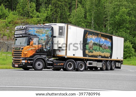 FORSSA, FINLAND - JUNE 21, 2015: Scania V8 temperature controlled food transport truck stops at intersection. Refrigerated trucks haul a variety of goods that require a climate-controlled handling. - stock photo