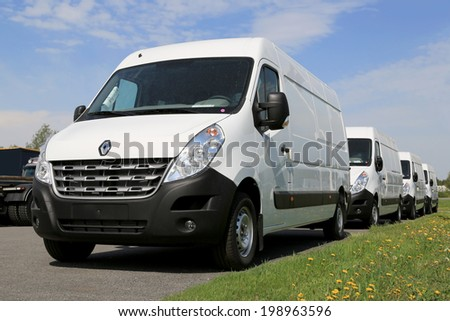 FORSSA, FINLAND - MAY 25, 2014: Row of third generation Renault Master vans. Renault Trucks presents the new Renault Master at the CV show in Birmingham. - stock photo