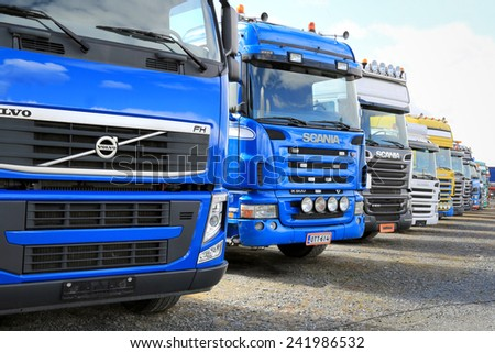 FORSSA, FINLAND - MAY 2, 2014: Row of used Volvo and Scania trucks. In Finland ca. 550 000 - 600 000 sales of used vehicles are made annually.  - stock photo
