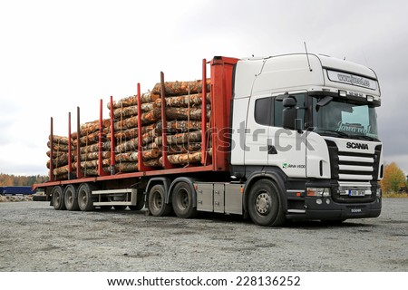 FORSSA, FINLAND - OCTOBER 5, 2014: Scania R480 Truck and Nurmi timber bunk with a load of birch logs. The timber bunks are made of high strength steel and have a capacity of 7 tons/bunk. - stock photo