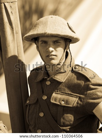 FORT GEORGE, SCOTLAND - AUGUST 11: An unidentified actor in World War 1 costume entertains the crowds at the annual Celebration Of The Centuries event on August 11, 2012 at Fort George, Scotland. - stock photo