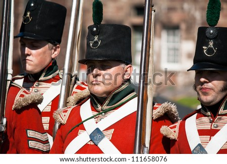 "FORT GEORGE, SCOTLAND- AUGUST 11 : Redcoat soldiers marching during the annual ""Celebration of the Centuries"" event at Fort George, Scotland, August 11, 2012"