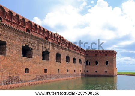 Fort Jefferson, in Dry Tortugas National Park, is surrounded by a moat of sea water - stock photo