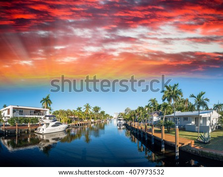 Fort Lauderdale at sunset, Florida. Canals and homes along the river. - stock photo