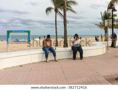 FORT LAUDERDALE, FL - JANUARY 13: Ft Lauderdale beach and boardwalk, separated by an attractive swirling white wall , photographed on January 13, 2016  - stock photo