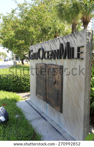 FORT LAUDERDALE, FL, USA - APRIL 7, 2014: Large stone and metal sign welcoming visitors to the Galt Ocean Mile community in North Fort Lauderdale. An historic metal neighborhood sign. - stock photo