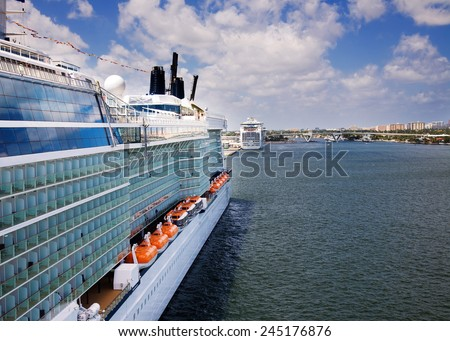 FORT LAUDERDALE, FLORIDA-MARCH 22:  Luxury cruise ship the Carnival Freedom pulls out from the dock in Ft. Lauderdale on March 22, 2009. - stock photo
