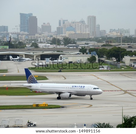 FORT LAUDERDALE - JULY 21: United Airlines Airbus A-320 passenger jet arrives in Fort Lauderdale, FL on July 21, 2013 after a flight from its home base in Chicago, IL. - stock photo