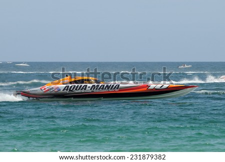 FORT LAUDERDALE - JUNE 7: Aqua Mania speed boat takes part in the 5th Annual Ft Lauderdale Super Boat Grand Prix sponsored by Panasonic. The event was held on June 7, 2009 in Fort Lauderdale, Florida - stock photo