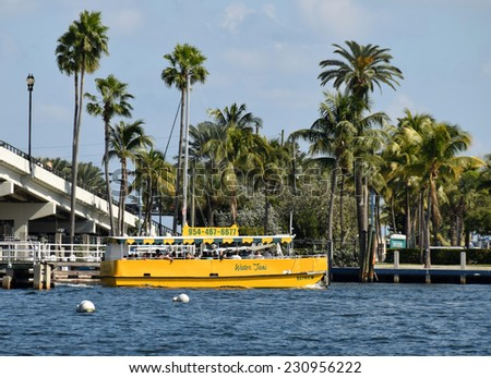 FORT LAUDERDALE - NOVEMBER 15: Tourists enjoy a trip along Fort Lauderdale's waterways aboard a water taxi on November 15, 2014. Florida's coastline is known for its numerous waterways. - stock photo