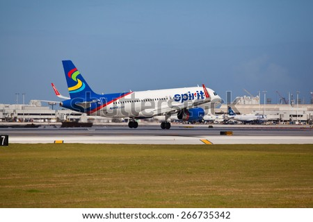 FORT LAUDERDALE, USA - April 5, 2015: A Spirit Airlines Airbus A320 landing at the Ft. Lauderdale/Hollywood International Airport, FL. Spirit Airlines has its operating base in Fort Lauderdale. - stock photo
