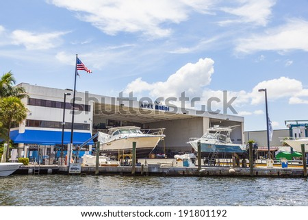 FORT LAUDERDALE, USA - AUG 1: boats at waterfront homes on Aug 1, 2010 in Fort Lauderdale. There are 165 miles  of waterways within the city limits and 9,8 percent of the city is covered by water. - stock photo