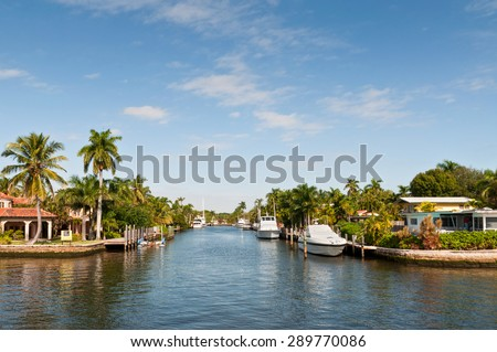 FORT LAUDERDALE, USA - DECEMBER 8: Boats at waterfront homes in Fort Lauderdale at December 8, 2011. There are 165 miles of waterways within the city limits.  - stock photo