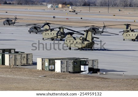 FORT RILEY, KS - FEBRUARY 8: Chinook and Black Hawk helicopters parked at Fort Riley, Kansas on February 8, 2015. Fort Riley is a US Army Installation and home of the 1st Infantry Division. - stock photo